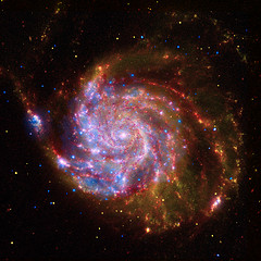 Not created on a computer using mathematics. This is A Spectacular Image to Celebrate the International Year of Astro - This image of M101 is a composite of data from NASA's Chandra X-ray Observatory, Spitzer Space Telescope, and Hubble Space