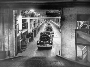 In April 1947, The Assembly line of Ford plant is halted for the day of Henry Ford's funeral