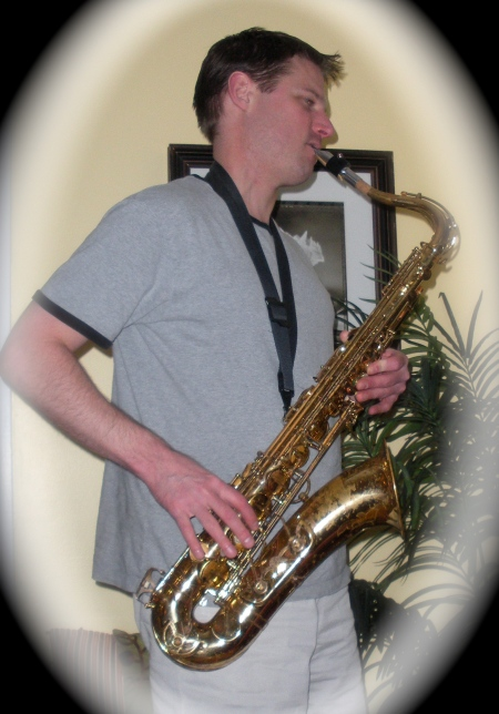 Erik (Playing sax for his girls, 38 years old)