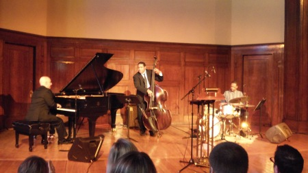Peter Martin, Chris Thomas, and Maurice Carnes performing on the stage of the Sheldon Concert Hall at the Celebration of Life for Erik Rogers.